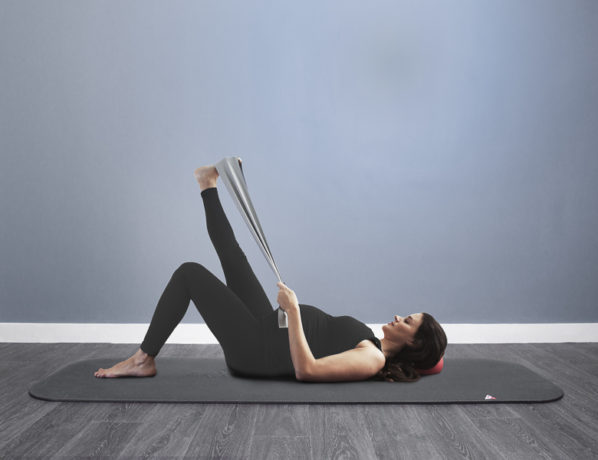 Pregnant women doing pilates with a stretch band